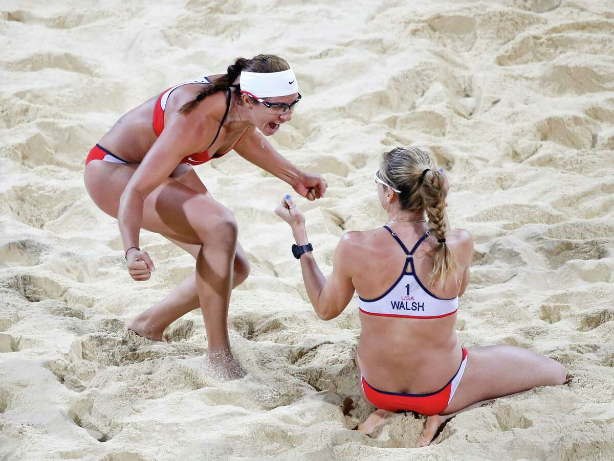 United States's Kerri Walsh Jennings, right, and Misty May-Treanor celebrate after defeating April Ross and Jennifer Kessy in a women's gold medal beach volleyball match at the 2012 Summer Olympics, London, Wednesday.