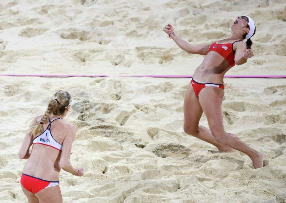 United States's Kerri Walsh Jennings, left, and Misty May-Treanor, celebrate after defeating April Ross and Jennifer Kessy in a women's gold medal beach volleyball match at the 2012 Summer Olympics, London, Wednesday. Photo: Ap