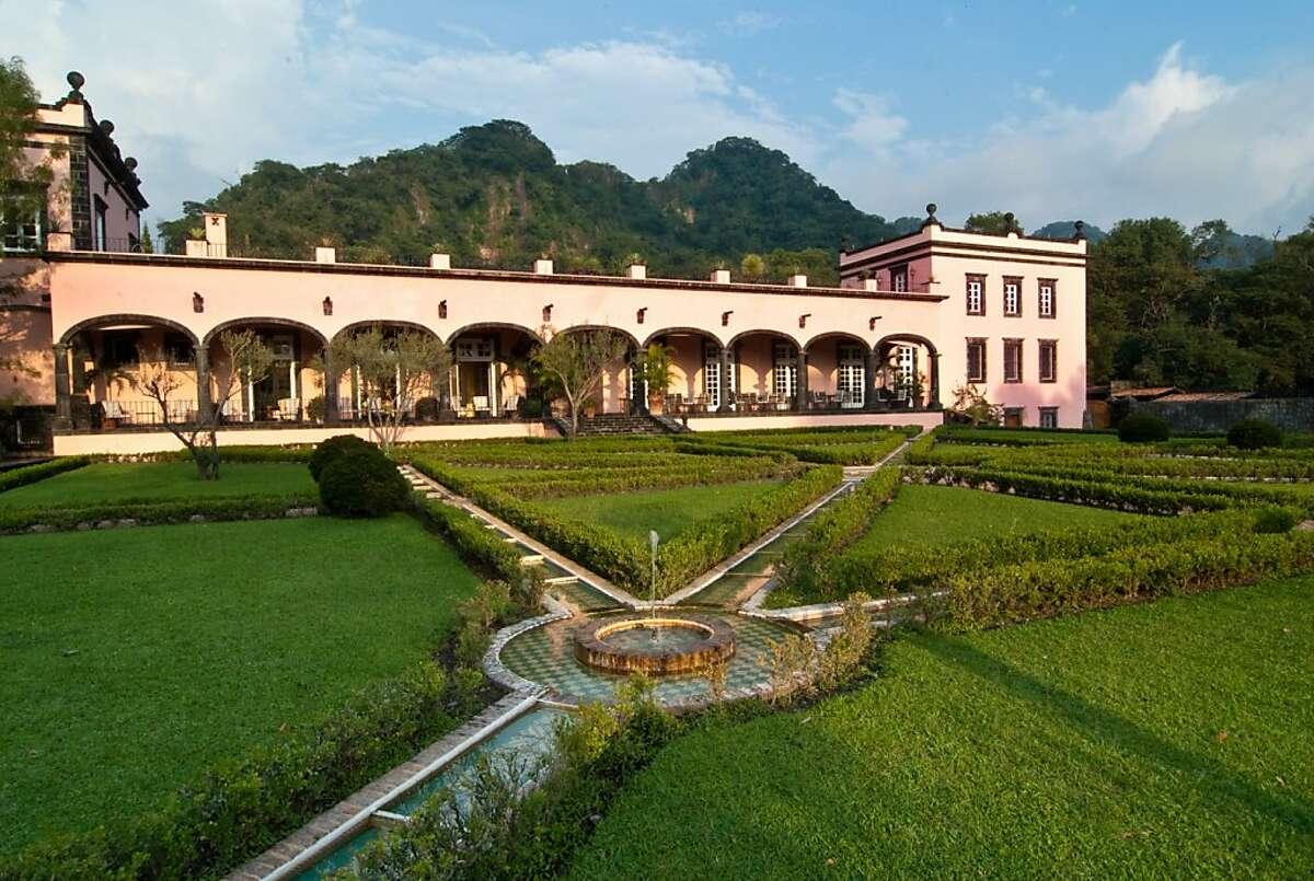 The 25-room Hacienda de San Antonio sits on a 5,000-acre plantation that grows organic produce.