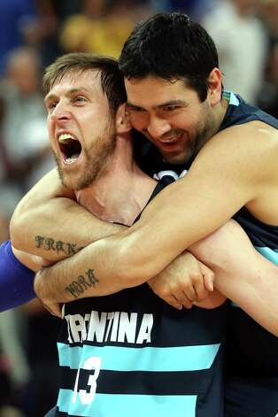LONDON, ENGLAND - AUGUST 08:  Andres Nocioni #13 and Martin Leiva #12 of Argentina celebrate Argentina's 82-77 victory against Brazil during the Men's Basketball quaterfinal game on Day 12 of the London 2012 Olympic Games at North Greenwich Arena on August 8, 2012 in London, England. Photo: Christian Petersen, Getty Images / 2012 Getty Images
