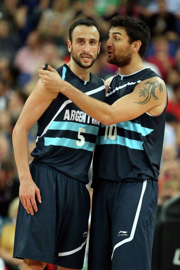 LONDON, ENGLAND - AUGUST 08:  Manu Ginobili #5 and Carlos Delfino #10 of Argentina celebrate late in the fourth quarter before Argentina's 82-77 victory against Brazil during the Men's Basketball quaterfinal game on Day 12 of the London 2012 Olympic Games at North Greenwich Arena on August 8, 2012 in London, England. Photo: Christian Petersen, Getty Images / 2012 Getty Images