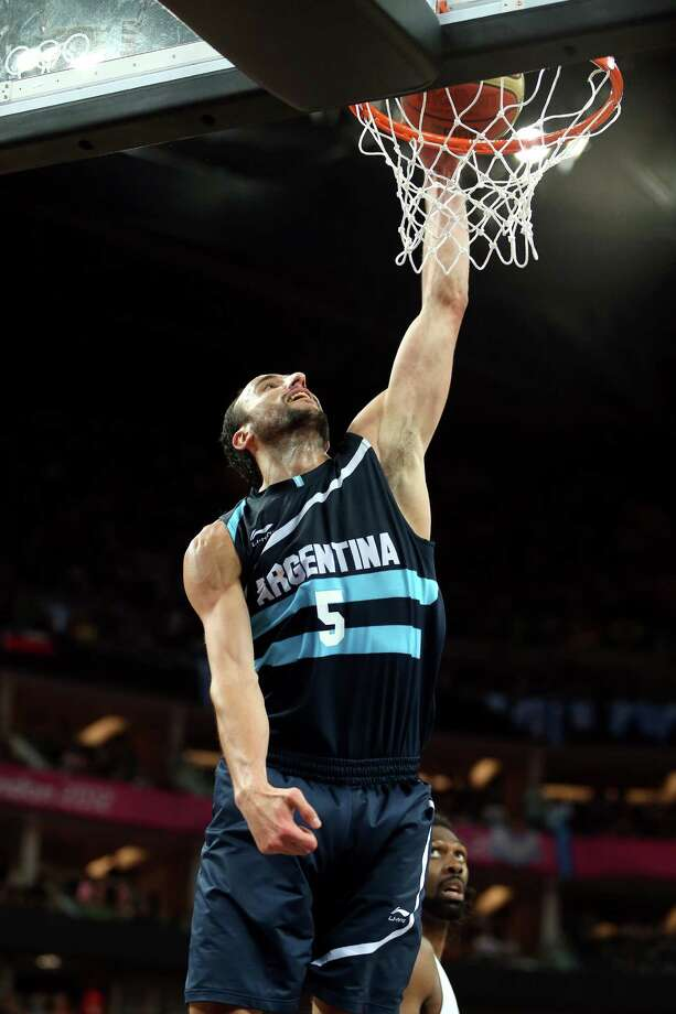 LONDON, ENGLAND - AUGUST 08:  Manu Ginobili #5 of Argentina dunks the ball in the second half while taking on Brazil during the Men's Basketball quaterfinal game on Day 12 of the London 2012 Olympic Games at North Greenwich Arena on August 8, 2012 in London, England. Photo: Christian Petersen, Getty Images / 2012 Getty Images