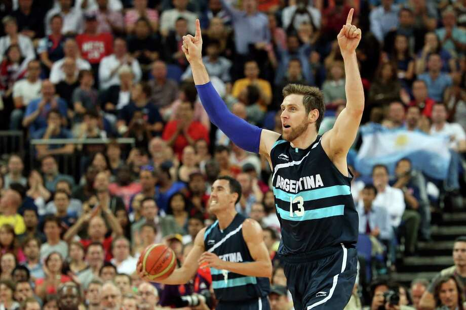LONDON, ENGLAND - AUGUST 08:  Andres Nocioni #13 of Argentina celebrates late in the fourth quarter before Argentina's 82-77 victory against Brazil during the Men's Basketball quaterfinal game on Day 12 of the London 2012 Olympic Games at North Greenwich Arena on August 8, 2012 in London, England. Photo: Christian Petersen, Getty Images / 2012 Getty Images