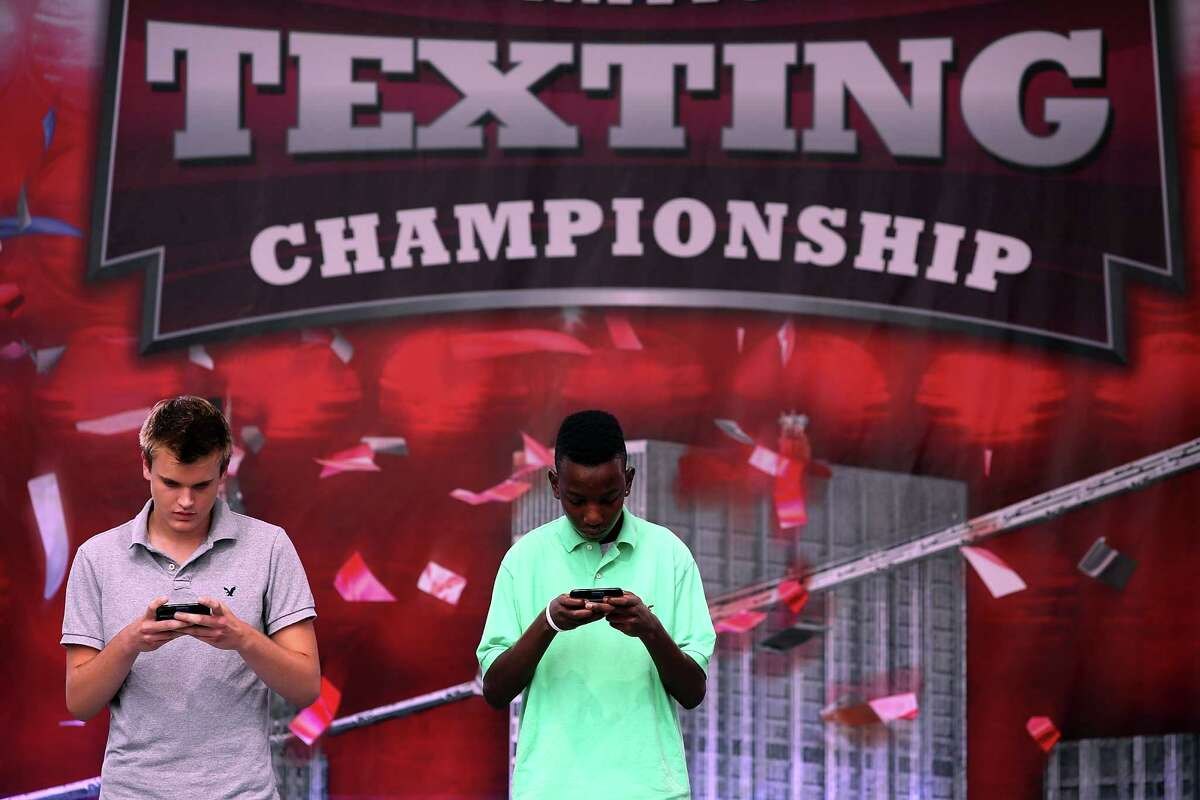 NEW YORK, NY - AUGUST 08: Austin Wierschke (left) and Kent Augustine compete in the final round of the Sixth Annual LG Mobile U.S. National Texting Championships on August 8, 2012 in New York City. This years winner was again Austin Wierschke who took home $50,000.