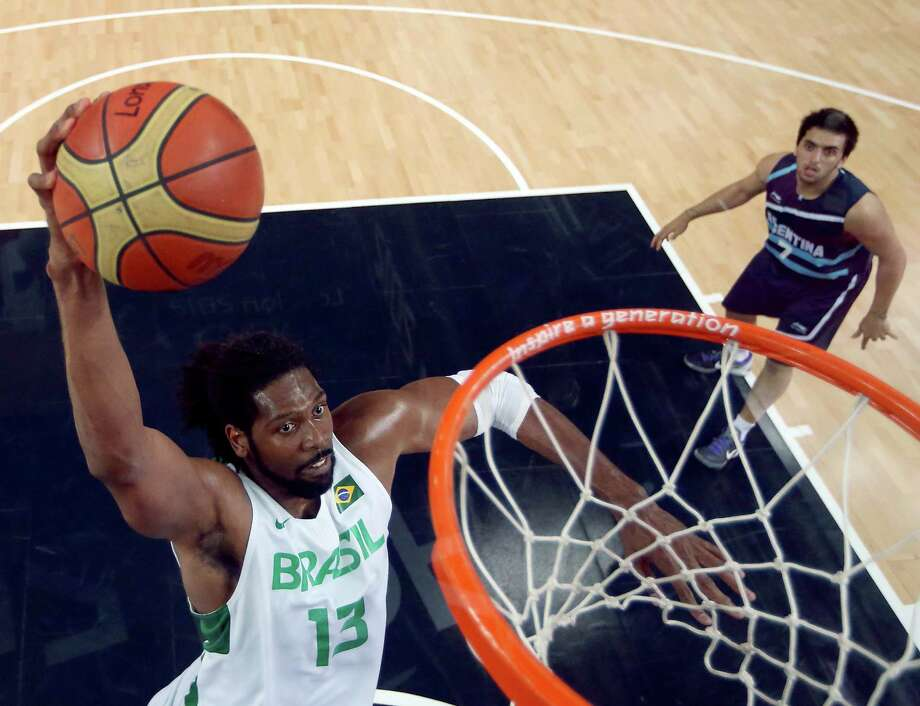 LONDON, ENGLAND - AUGUST 08:  (EDITORS NOTE: A polarizing filter was used for this image.) Nene Hilario #13 of Brazil goes up for a dunk in the second quarter against Argentina during the Men's Basketball quaterfinal game on Day 12 of the London 2012 Olympic Games at North Greenwich Arena on August 8, 2012 in London, England. Photo: Christian Petersen, Getty Images / 2012 Getty Images