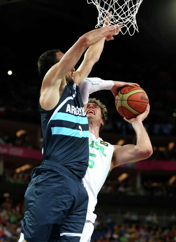 LONDON, ENGLAND - AUGUST 08:  Tiago Splitter #15 of Brazil goes up for a shot against Manu Ginobili #5 of Argentina in the first half during the Men's Basketball quaterfinal game on Day 12 of the London 2012 Olympic Games at North Greenwich Arena on August 8, 2012 in London, England. Photo: Christian Petersen, Getty Images / 2012 Getty Images