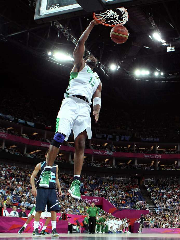 LONDON, ENGLAND - AUGUST 08:  Nene Hilario #13 of Brazil dunks the ball in the first half against Argentina during the Men's Basketball quaterfinal game on Day 12 of the London 2012 Olympic Games at North Greenwich Arena on August 8, 2012 in London, England. Photo: Christian Petersen, Getty Images / 2012 Getty Images