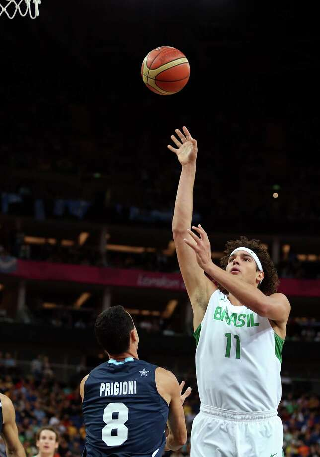 LONDON, ENGLAND - AUGUST 08:  Anderson Varejao #11 of Brazil shoots the ball over Pablo Prigioni #8 of Argentina in the first half during the Men's Basketball quaterfinal game on Day 12 of the London 2012 Olympic Games at North Greenwich Arena on August 8, 2012 in London, England. Photo: Christian Petersen, Getty Images / 2012 Getty Images