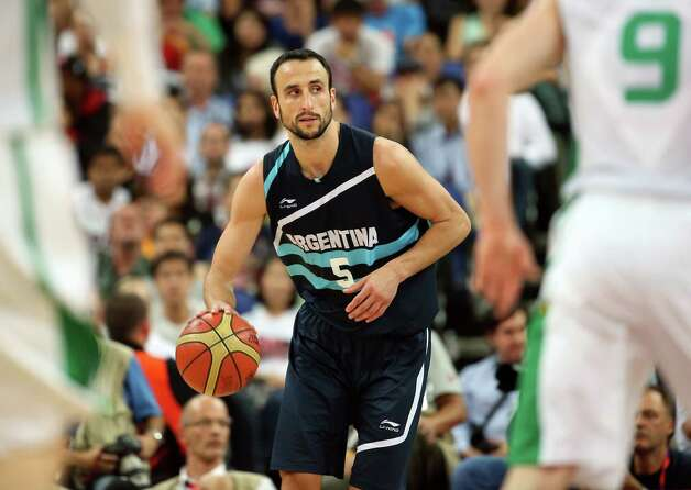 LONDON, ENGLAND - AUGUST 08:  Manu Ginobili #5 of Argentina moves the ball in the second half while taking on Brazil during the Men's Basketball quaterfinal game on Day 12 of the London 2012 Olympic Games at North Greenwich Arena on August 8, 2012 in London, England. Photo: Christian Petersen, Getty Images / 2012 Getty Images