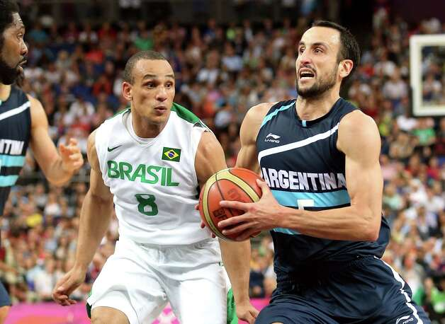 LONDON, ENGLAND - AUGUST 08:  Manu Ginobili #5 of Argentina moves the ball against Alex Garcia #8 of Brazil in the second half during the Men's Basketball quaterfinal game on Day 12 of the London 2012 Olympic Games at North Greenwich Arena on August 8, 2012 in London, England. Photo: Christian Petersen, Getty Images / 2012 Getty Images