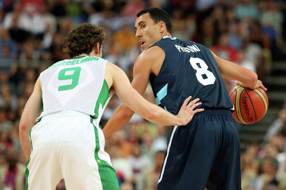 LONDON, ENGLAND - AUGUST 08:  Pablo Prigioni #8 of Argentina moves the ball against Marcelinho Huertas #9 of Brazil in the second half during the Men's Basketball quaterfinal game on Day 12 of the London 2012 Olympic Games at North Greenwich Arena on August 8, 2012 in London, England. Photo: Christian Petersen, Getty Images / 2012 Getty Images