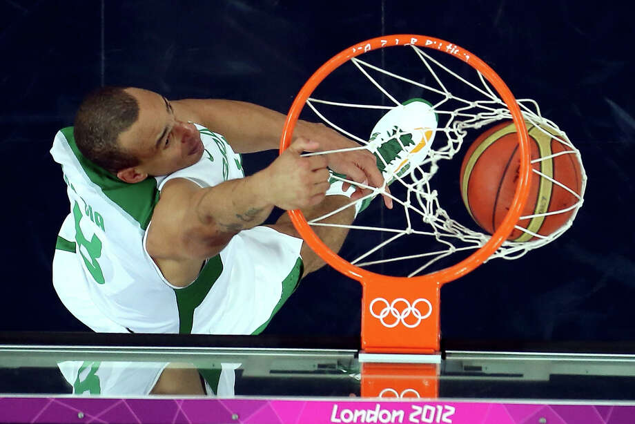 LONDON, ENGLAND - AUGUST 08:  Alex Garcia #8 of Brazil dunks the ball in the second half while taking on Argentina during the Men's Basketball quaterfinal game on Day 12 of the London 2012 Olympic Games at North Greenwich Arena on August 8, 2012 in London, England. Photo: Ronald Martinez, Getty Images / 2012 Getty Images