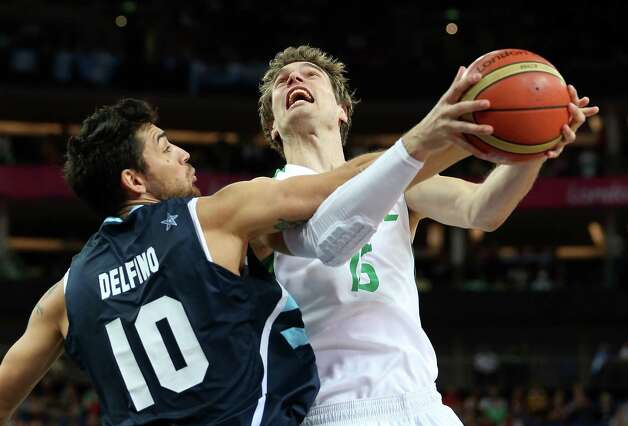 LONDON, ENGLAND - AUGUST 08:  Tiago Splitter #15 of Brazil goes up for a shot against Carlos Delfino #10 of Argentina in the first half during the Men's Basketball quaterfinal game on Day 12 of the London 2012 Olympic Games at North Greenwich Arena on August 8, 2012 in London, England. Photo: Christian Petersen, Getty Images / 2012 Getty Images