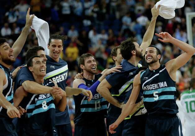 Argentina celebrates their win over Brazil in a quarterfinal men's basketball game at the 2012 Summer Olympics, Wednesday, Aug. 8, 2012, in London. (AP Photo/Eric Gay) Photo: Eric Gay, Associated Press / AP