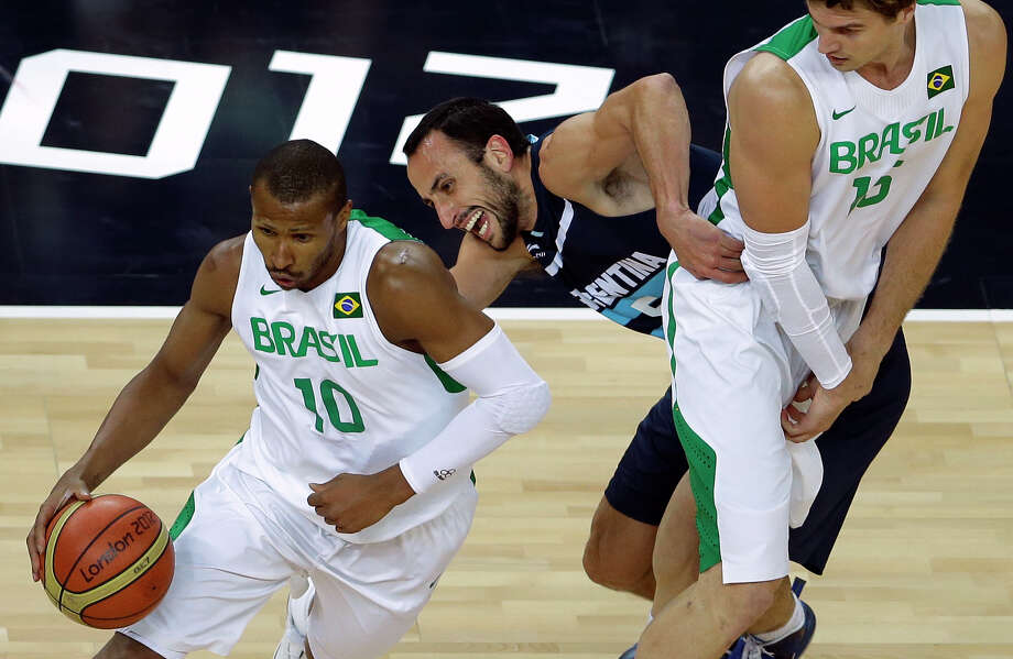 Brazil's Leandrinho Barbosa, left, drives past Argentina's Manu Ginobili, center, as Brazil's Tiago Splitter, right, defends during a men's basketball quarterfinal game at the 2012 Summer Olympics, Wednesday, Aug. 8, 2012, in London. (AP Photo/Victor R. Caivano) Photo: Victor R. Caivano, Associated Press / AP