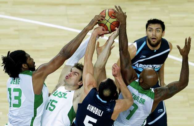 Brazil's Nene Hilario, left, Brazil's Tiago Splitter, second left, Argentina's Manu Ginobili, center, and Brazil's Larry Taylor, right, jump for a rebound during a men's basketball quarterfinal game at the 2012 Summer Olympics, Wednesday, Aug. 8, 2012, in London. (AP Photo/Victor R. Caivano) Photo: Victor R. Caivano, Associated Press / AP