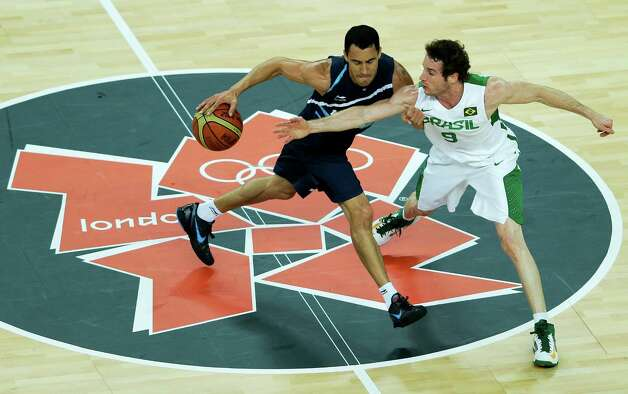 Argentina's Pablo Prigioni, left, is defended by Brazil's Marcelinho Huertas, right, during a men's basketball quarterfinal game at the 2012 Summer Olympics, Wednesday, Aug. 8, 2012, in London. (AP Photo/Victor R. Caivano) Photo: Victor R. Caivano, Associated Press / AP