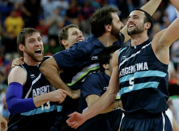 Argentina's Andres Nocioni (13) and Manu Ginobili (5) celebrate with teammates after defeating Brazil in a quarterfinal men's basketball game at the 2012 Summer Olympics, Wednesday, Aug. 8, 2012, in London. (AP Photo/Eric Gay) Photo: Eric Gay, Associated Press / AP