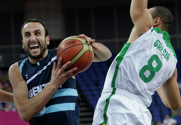 Argentina's Manu Ginobili, left, drives to the basket past Brazil's Alex Garcia (8) during a quarterfinal men's basketball game at the 2012 Summer Olympics, Wednesday, Aug. 8, 2012, in London. (AP Photo/Eric Gay) Photo: Eric Gay, Associated Press / AP
