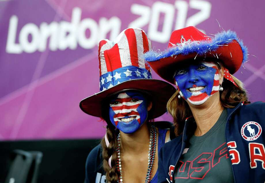 LONDON, ENGLAND - AUGUST 08:  United States fans in the stand during the Women's Beach Volleyball on Day 12 of the London 2012 Olympic Games at the Horse Guard's Parade on August 8, 2012 in London, England. Photo: Jamie Squire, Getty Images / 2012 Getty Images
