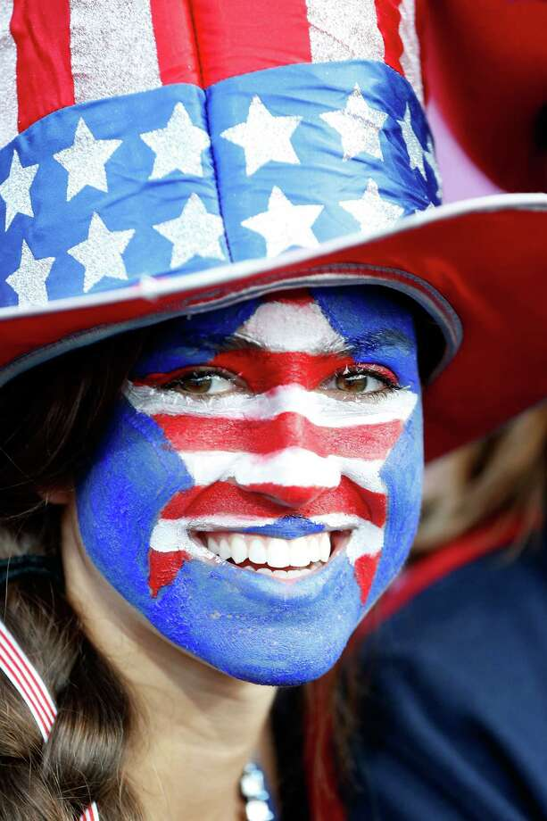 LONDON, ENGLAND - AUGUST 08:  A United States fan with her face painted in the stands during the Women's Beach Volleyball on Day 12 of the London 2012 Olympic Games at the Horse Guard's Parade on August 8, 2012 in London, England. Photo: Jamie Squire, Getty Images / 2012 Getty Images