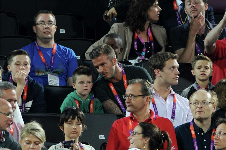 LONDON, ENGLAND - AUGUST 08:  (L-R) Brooklyn Beckham, Cruz Beckham, David Beckham and Romeo Beckham watch Beach Volleyball on Day 12 of the London 2012 Olympic Games at Horse Guards Parade on August 8, 2012 in London, England. Photo: Pascal Le Segretain, Getty Images / 2012 Getty Images