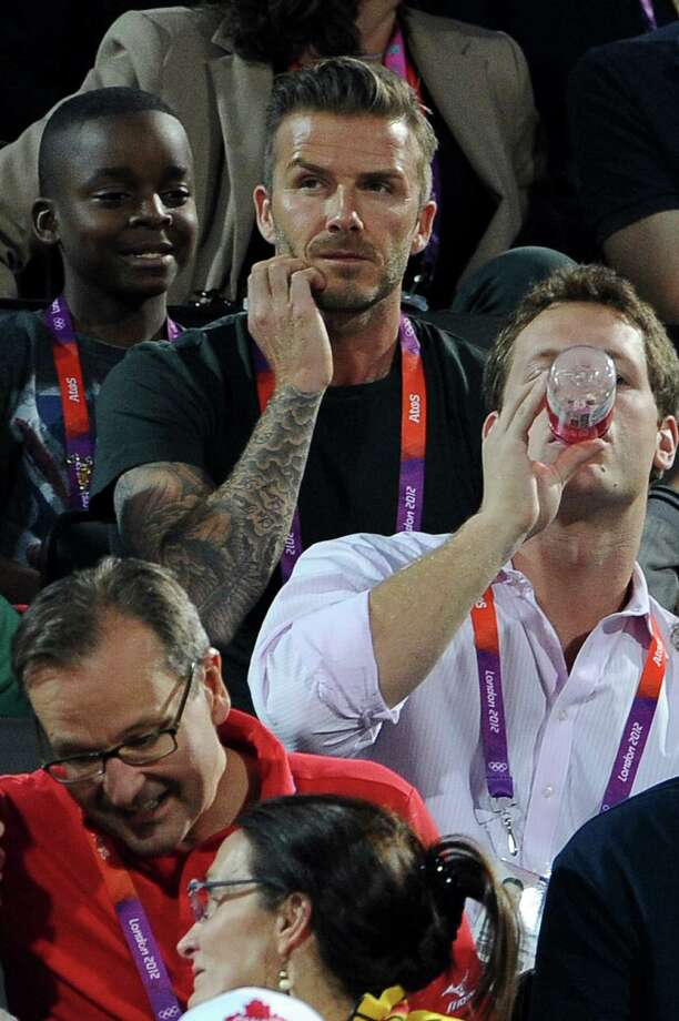 LONDON, ENGLAND - AUGUST 08:  (L-R) David Beckham watches Beach Volleyball on Day 12 of the London 2012 Olympic Games at Horse Guards Parade on August 8, 2012 in London, England. Photo: Pascal Le Segretain, Getty Images / 2012 Getty Images