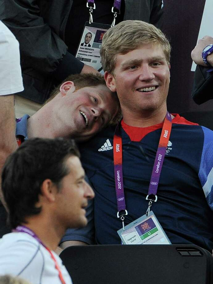 LONDON, ENGLAND - AUGUST 08:  Prince Harry and British rower Constantine Louloudis watch Beach Volleyball on Day 12 of the London 2012 Olympic Games at Horse Guards Parade on August 8, 2012 in London, England. Photo: Pascal Le Segretain, Getty Images / 2012 Getty Images