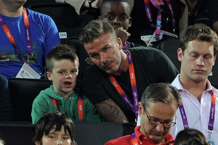 LONDON, ENGLAND - AUGUST 08:  David Beckham (R) and his son Cruz Beckham watch Beach Volleyball on Day 12 of the London 2012 Olympic Games at Horse Guards Parade on August 8, 2012 in London, England. Photo: Pascal Le Segretain, Getty Images / 2012 Getty Images