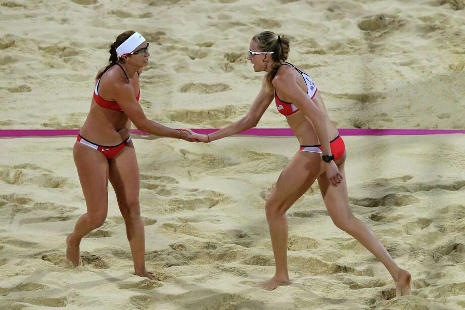 LONDON, ENGLAND - AUGUST 08:  Misty May-Treanor (L) and Kerri Walsh Jennings of the United States celebrate a point during the Women's Beach Volleyball Gold medal match against the United States on Day 12 of the London 2012 Olympic Games at the Horse Guard's Parade on August 8, 2012 in London, England. Photo: Ryan Pierse, Getty Images / 2012 Getty Images