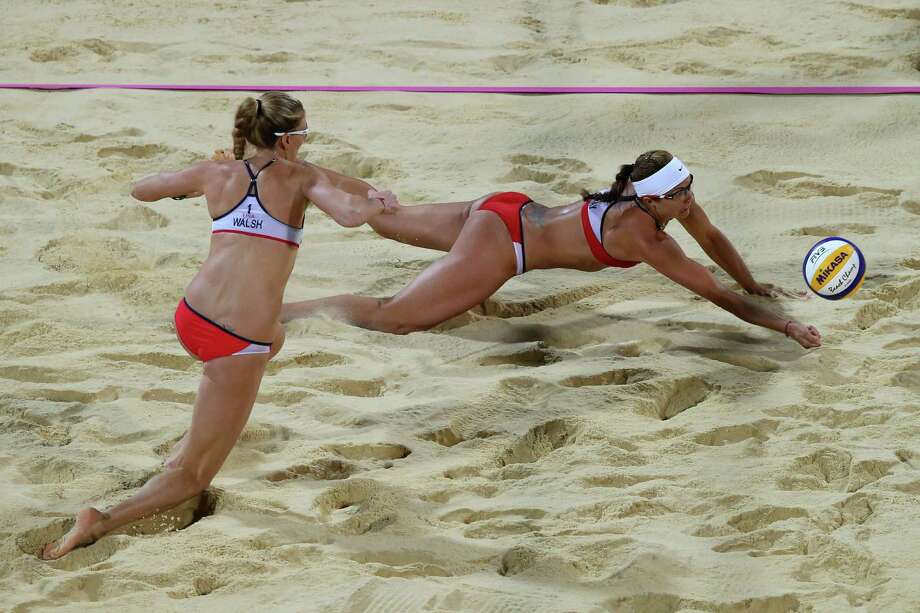 LONDON, ENGLAND - AUGUST 08:  Misty May-Treanor (R) of the United States dives for the ball during the Women's Beach Volleyball Gold medal match against the United States on Day 12 of the London 2012 Olympic Games at the Horse Guard's Parade on August 8, 2012 in London, England. Photo: Ryan Pierse, Getty Images / 2012 Getty Images