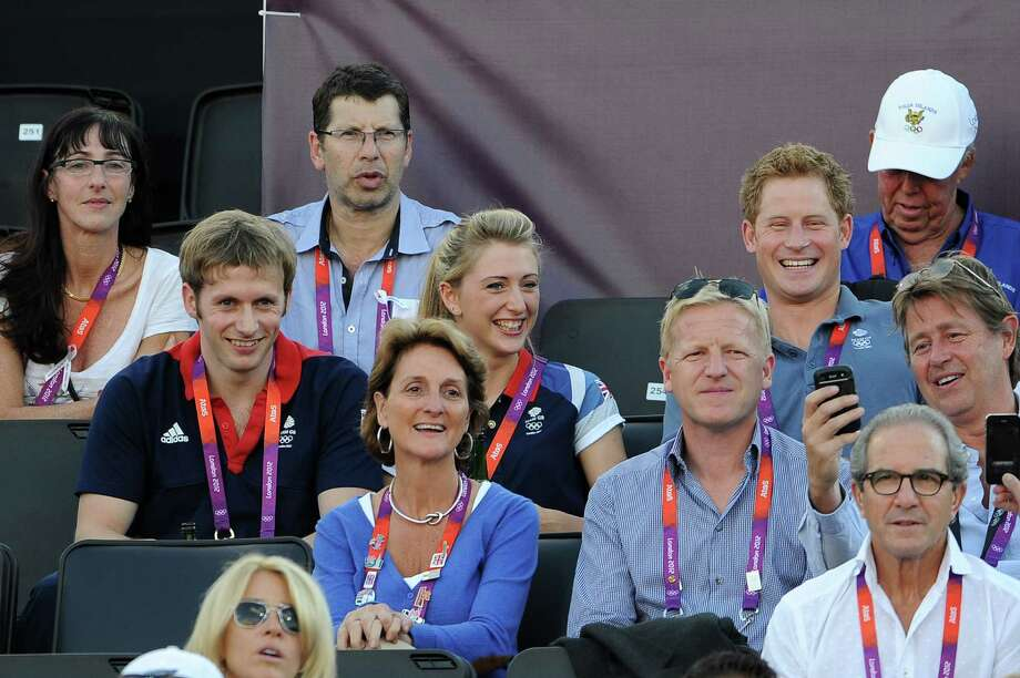 LONDON, ENGLAND - AUGUST 08:  (L-R) British cyclists Jason Kenny and Laura Trott watch Beach Volleyball with Prince Harry on Day 12 of the London 2012 Olympic Games at Horse Guards Parade on August 8, 2012 in London, England. Photo: Pascal Le Segretain, Getty Images / 2012 Getty Images