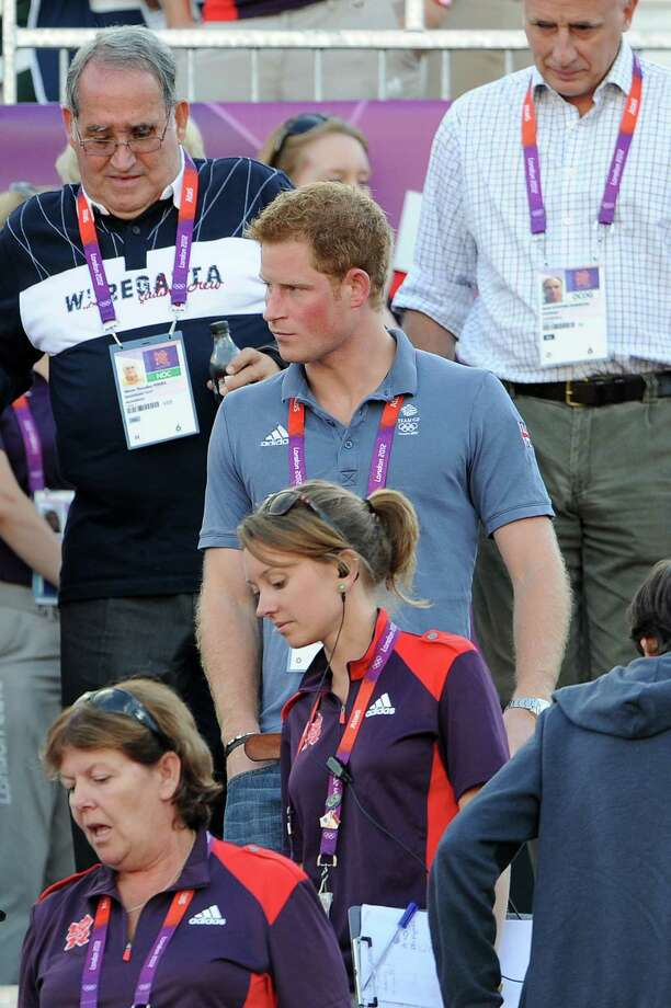 LONDON, ENGLAND - AUGUST 08: Prince Harry takes his seat to watch the Beach Volleyball on Day 12 of the London 2012 Olympic Games at Horse Guards Parade on August 8, 2012 in London, England. Photo: Pascal Le Segretain, Getty Images / 2012 Getty Images