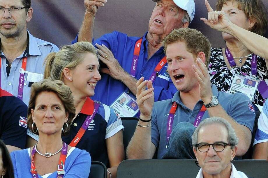 LONDON, ENGLAND - AUGUST 08:  British cyclist Laura Trott (L) watches Beach Volleyball with Prince Harry on Day 12 of the London 2012 Olympic Games at Horse Guards Parade on August 8, 2012 in London, England. Photo: Pascal Le Segretain, Getty Images / 2012 Getty Images