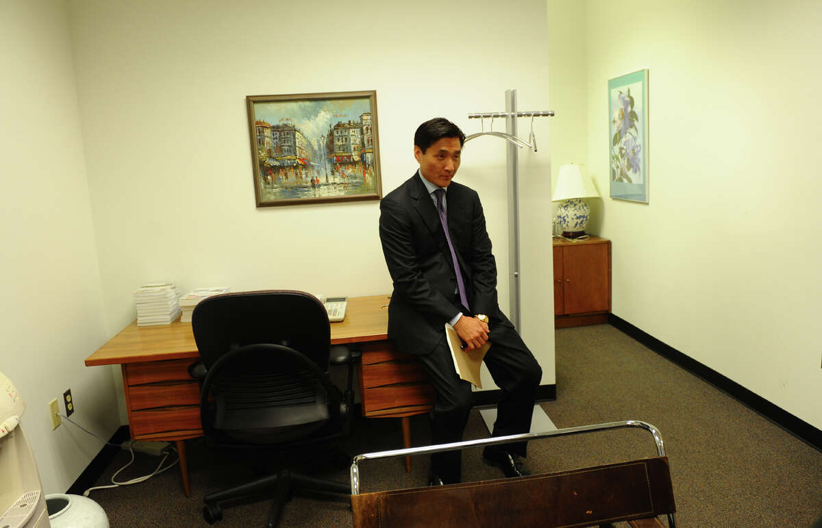 City attorney Sung-Ho Hwang in his office after a press conference, where he gave a statement about his arrest for carrying a concealed weapon at a movie theater, in New Haven, Conn. on Wednesday August 8, 2012.