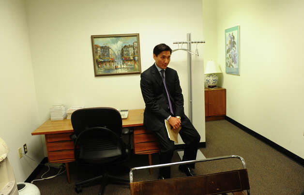 City attorney Sung-Ho Hwang in his office after a press conference, where he gave a statement about his arrest for carrying a concealed weapon at a movie theater, in New Haven, Conn. on Wednesday August 8, 2012. Photo: Christian Abraham / Connecticut Post