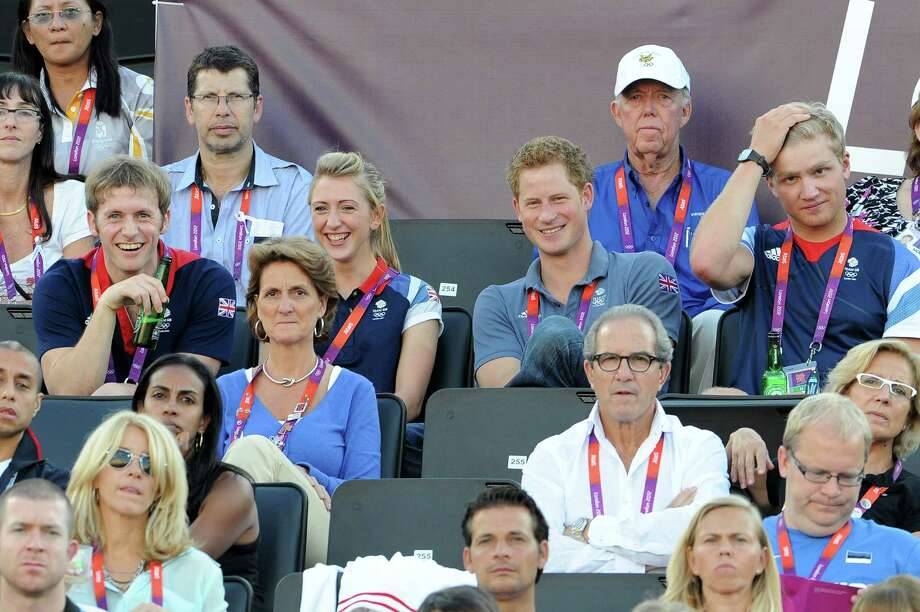 LONDON, ENGLAND - AUGUST 08:  (L-R) British cyclists Jason Kenny and Laura Trott watch Beach Volleyball with Prince Harry and British rower Constantine Louloudis on Day 12 of the London 2012 Olympic Games at Horse Guards Parade on August 8, 2012 in London, England. Photo: Pascal Le Segretain, Getty Images / 2012 Getty Images