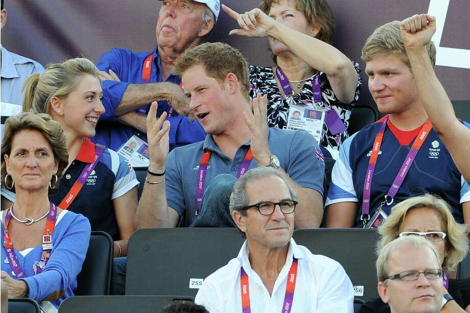LONDON, ENGLAND - AUGUST 08:  (L-R) British cyclist Laura Trott watches Beach Volleyball with Prince Harry and British rower Constantine Louloudis on Day 12 of the London 2012 Olympic Games at Horse Guards Parade on August 8, 2012 in London, England. Photo: Pascal Le Segretain, Getty Images / 2012 Getty Images