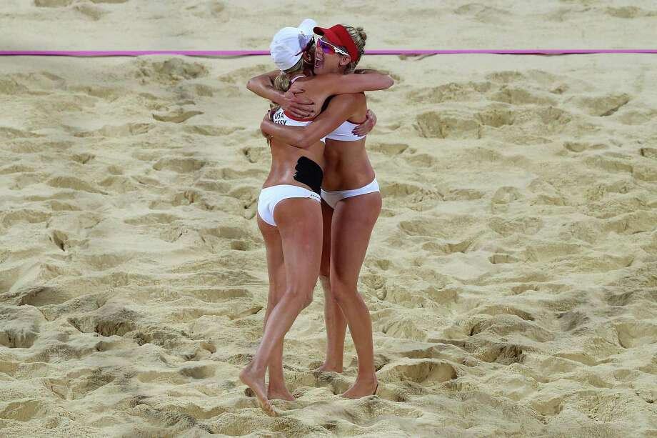 LONDON, ENGLAND - AUGUST 08:  Jennifer Kessy (L) and April Ross of the United States celebrate a point during the Women's Beach Volleyball Gold medal match on Day 12 of the London 2012 Olympic Games at the Horse Guard's Parade on August 8, 2012 in London, England. Photo: Ryan Pierse, Getty Images / 2012 Getty Images