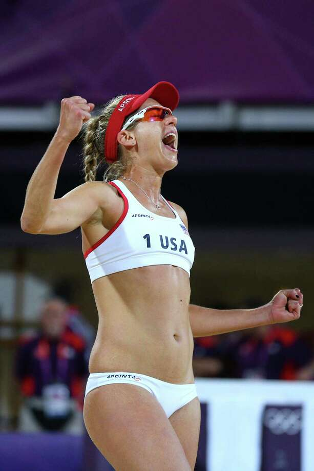 LONDON, ENGLAND - AUGUST 08:  April Ross of the United States celebrates a point during the Women's Beach Volleyball Gold medal match on Day 12 of the London 2012 Olympic Games at the Horse Guard's Parade on August 8, 2012 in London, England. Photo: Cameron Spencer, Getty Images / 2012 Getty Images