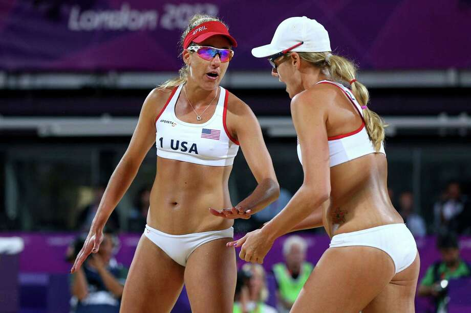 LONDON, ENGLAND - AUGUST 08:  Jennifer Kessy (R) and April Ross of the United States celebrate a point during the Women's Beach Volleyball Gold medal match on Day 12 of the London 2012 Olympic Games at the Horse Guard's Parade on August 8, 2012 in London, England. Photo: Cameron Spencer, Getty Images / 2012 Getty Images