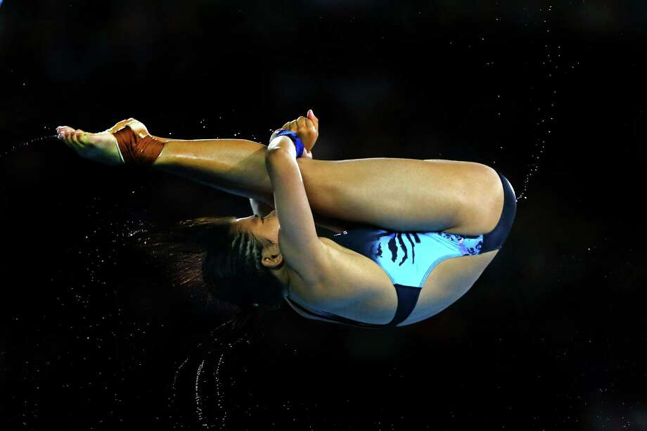 LONDON, ENGLAND - AUGUST 08:  Vivien Traisy Tukiet of Malaysia competes in the Women's 10m Platform Diving Preliminary on Day 12 of the London 2012 Olympic Games at the Aquatics Centre on August 8, 2012 in London, England. Photo: Al Bello, Getty Images / 2012 Getty Images