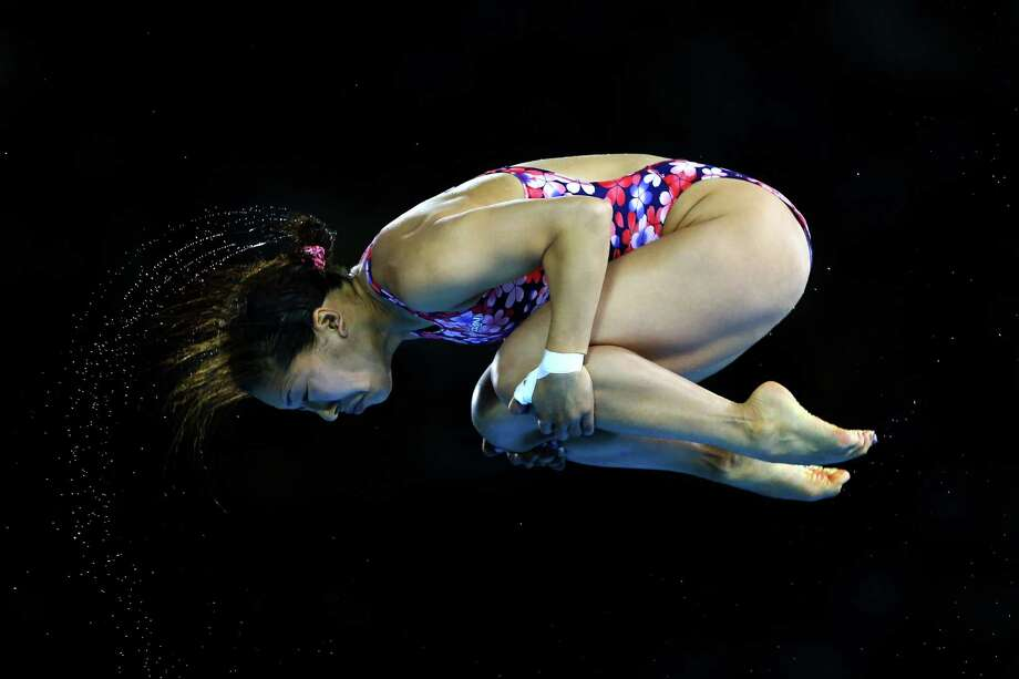 LONDON, ENGLAND - AUGUST 08:  Mai Nakagawa of Japan competes in the Women's 10m Platform Diving Preliminary on Day 12 of the London 2012 Olympic Games at the Aquatics Centre on August 8, 2012 in London, England. Photo: Al Bello, Getty Images / 2012 Getty Images