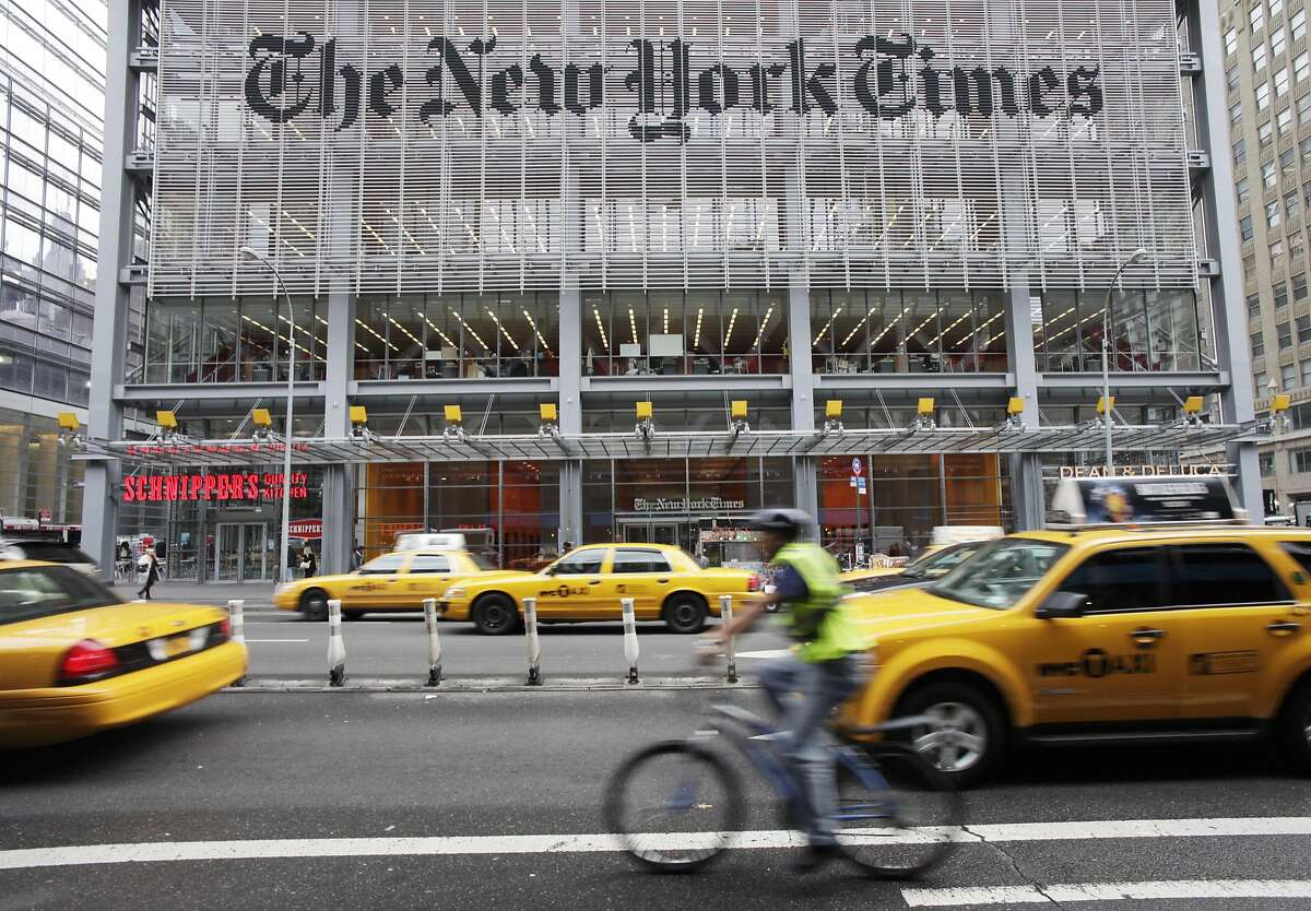 In this Oct. 18, 2011 photo, traffic passes the New York Times building, Tuesday, in New York. The New York Times Co. stock rose sharply on Thursday, July 26, 2012 after the media company reported that second-quarter revenue increased more than expected. (AP Photo/Mark Lennihan)