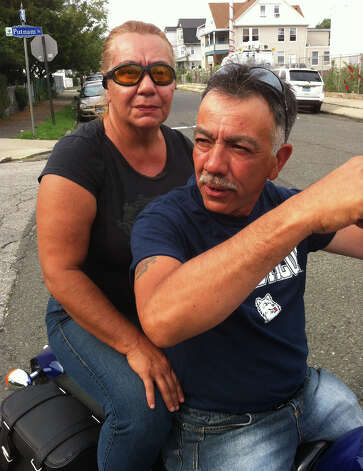 Edwin Diaz, here with his wife Evelyn, has lived on BridgeportâÄôs East Side since 1972. âÄúThis was my domain, but no more. The kids with guns took it from me,âÄù he said. Photo: John Burgeson / Connecticut Post