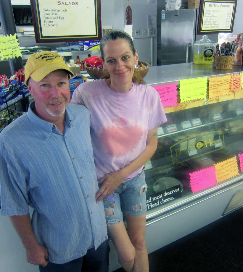 Joe Hinckley and Beverly Jajer have set up shop and enjoying every minute of their ownership of the Merryall Market. August 2012 Photo: Norm Cummings