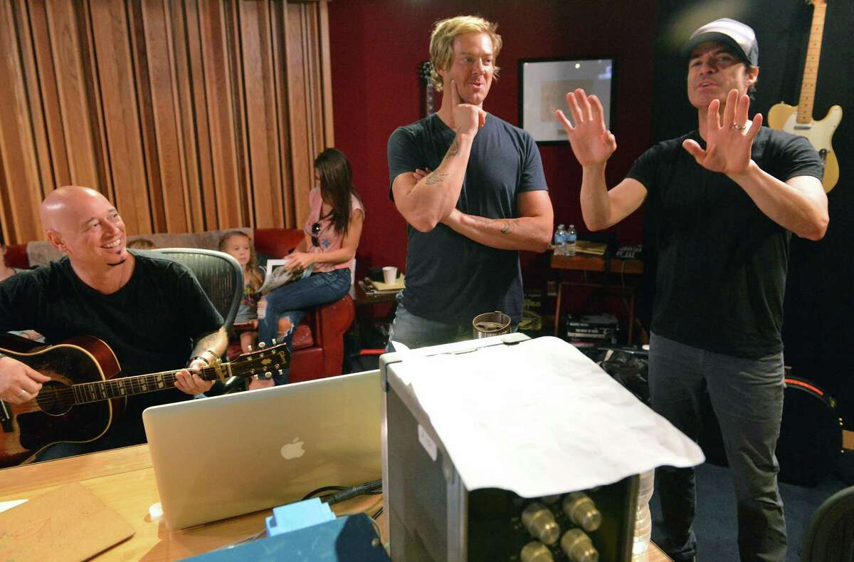 """Train's Jimmy Stafford, Scott Underwood and Pat Monahan during the recording of """"A Very Special Christmas 25th Anniversary"""" album at Blackbird Studio in Nashville, Tenn."""