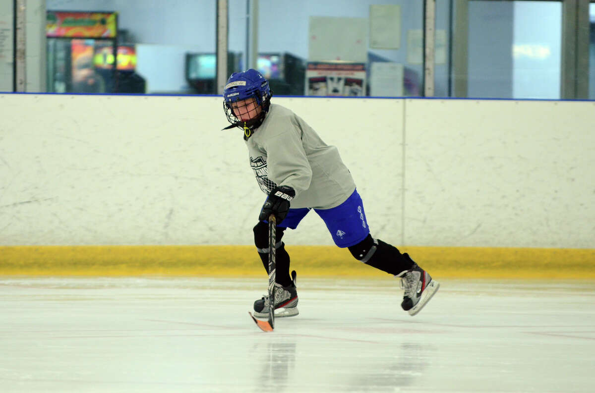 Andrew Smith, of Darien, practices a drill during the NHL Pee Wee ice hockey camp for students ages 11-12 at the Stamford Twin Rinks on Tuesday, Aug. 7, 2012. The weeklong camp is run by New Canaan's Max Pacioretty of the Montreal Canadiens .