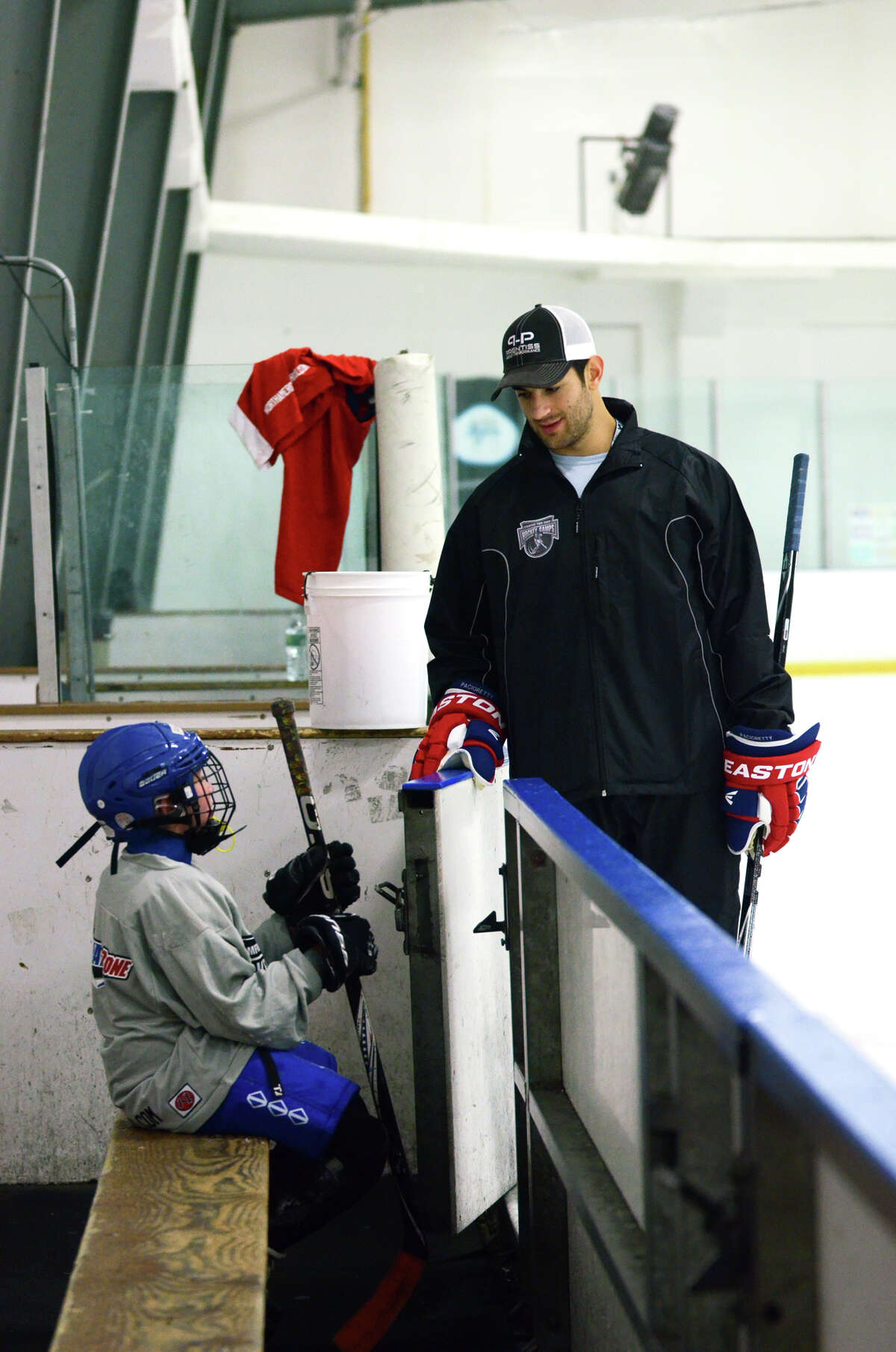Andrew Smith, of Darien, talks to camp coach Max Pacioretty during the NHL Pee Wee ice hockey camp for students ages 11-12 at the Stamford Twin Rinks on Tuesday, Aug. 7, 2012. The weeklong camp is run by New Canaan's Max Pacioretty of the Montreal Canadiens .