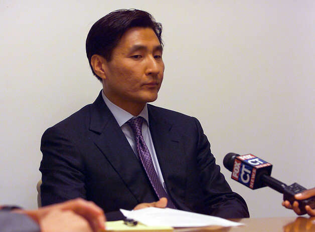 New Haven city attorney Sung-Ho Hwang, gives a statement to the media after being arrested for carrying a concealed weapon at a movie theater, at City Hall in downtown New Haven, Conn. on Wednesday August 8, 2012. Hwang doea have a permit to carry a concealed weapon. Photo: Christian Abraham / Connecticut Post